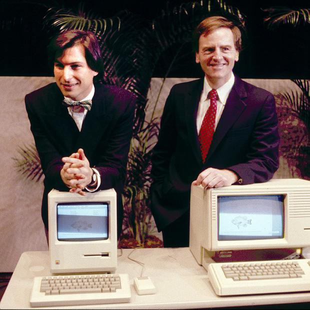 Apple CEO Steve Jobs, left and President John Sculley presenting the new Macintosh Desktop Computer in January 1984 (AP/file)
