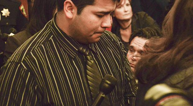 Erick Munoz is escorted out of court in Forth Worth (AP)