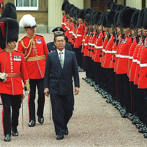 Alberto Fujimori, pictured inspecting a Guard of Honour at Buckingham Palace in 2001