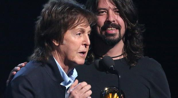 Paul McCartney, left, and Dave Grohl, accept the award for best rock song for Cut Me Some Slack at the Grammys (AP)