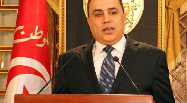 Interim prime minister Mehdi Jomaa addresses the media at the presidential palace in Carthage (AP)