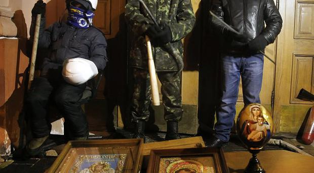 Protesters have seized four sizeable buildings in central Kiev, including the Justice Ministry (AP)