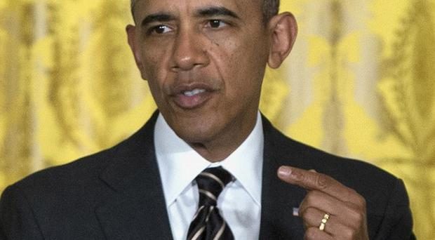 President Barack Obama's government is looking at ways to stop people from seeing whom the US is spying on (AP)