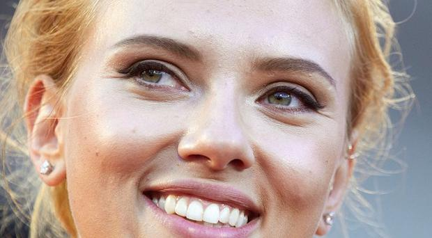 Actress Scarlett Johansson has ended her role as Oxfam ambassador (AP)