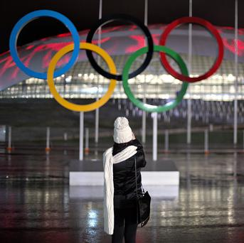 The Olympic rings against the background of Sochi's Bolshoy Ice Dome's roof light display of moving flames (AP)