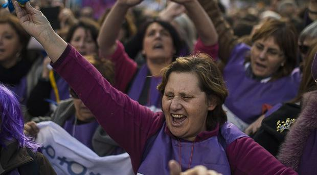 Protestors shout slogans as they march towards the Spanish Parliament during a protest against government's plan to implement major restrictions on abortion (AP)
