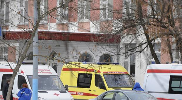 Ambulances are parked at an entrance to a school in Moscow, Russia, following a shooting (AP)