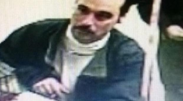 An imaage from a video surveillance camera release by the Michigan State Police shows Ionia Correctional Facility escapee Michael David Elliot, 40, at an Indiana Marathon gas station late Sunday night. A national manhunt was underway Monday for Elliot, a convicted killer who escaped Sunday from the Ionia Correctional Facility in Michigan. (AP Photo/Michigan State Police)