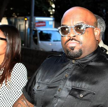 Thomas DeCarlo Callaway, right, known as Cee Lo Green arrives at the Los Angeles Superior Court (AP)