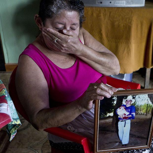 Maria Alvarenga holding a photograph of her son Jose Salvador Alvarenga (AP)