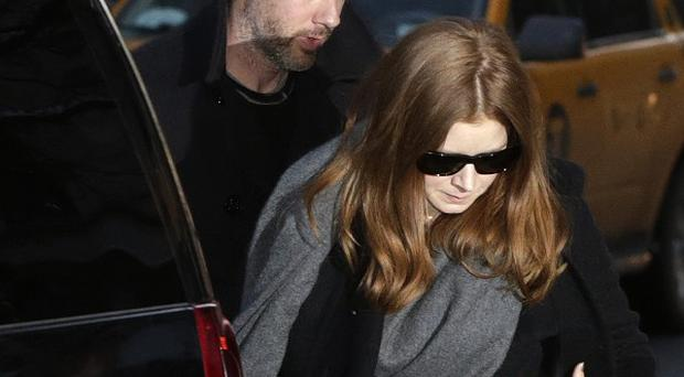 Oscar-nominated actress Amy Adams and her fiance Darren Le Gallo arrive at a wake for actor Philip Seymour Hoffman (AP)