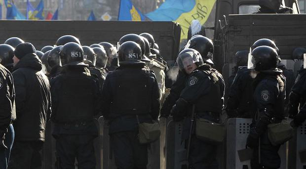 Ukrainian riot policemen block a street near the Ukrainian Parliament in Kiev (AP)