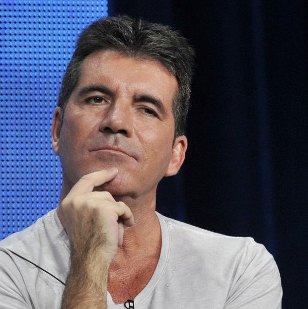 Simon Cowell will return to the UK version of The X Factor as the show will not be returning in the US this year (AP)