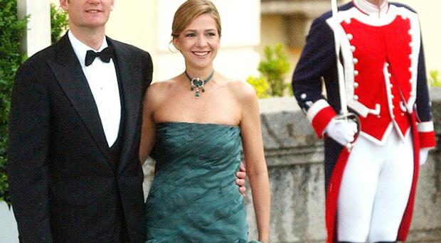 Spain's Princess Cristina, pictured with her husband Inaki Urdangarin, faces an unprecedented court appearance (AP)