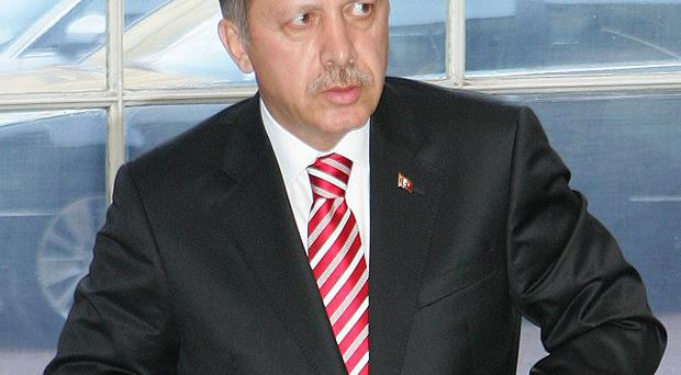 Prime Minister Recep Tayyip Erdogan has defended new laws governing the internet