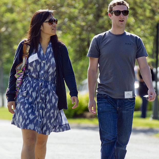 Mark Zuckerberg, president and CEO of Facebook, and wife Priscilla Chan were the most generous American philanthropists in 2013 (AP)