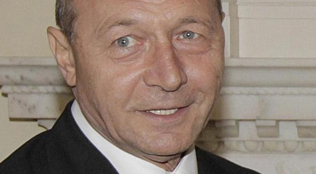 Romania's president Traian Basescu has been fined for comments about Roma