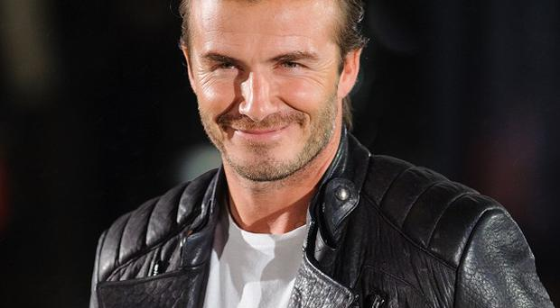 David Beckham has been welcomed by hundreds of people living in United Nations-provided tents in the typhoon-hit Philippines