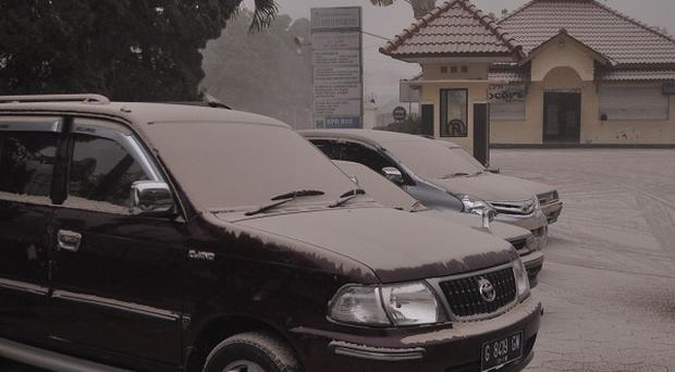 Vehicles are covered with volcanic ash from an eruption of Mount Kelud, in Yogyakarta, Indonesia (AP)