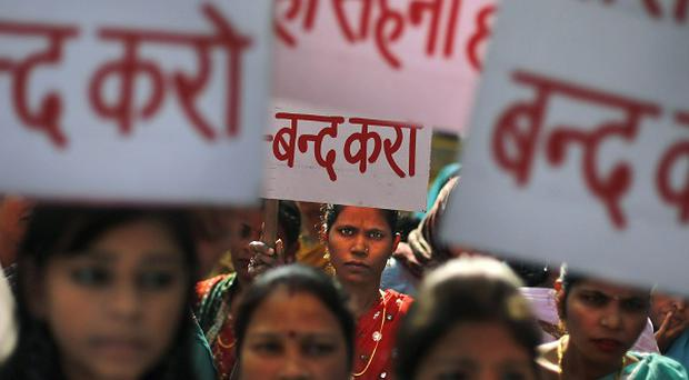 Women hold placards during a protest rally against Tarun Tejpal, editor-in-chief of Tehelka magazine, in New Delhi (AP)