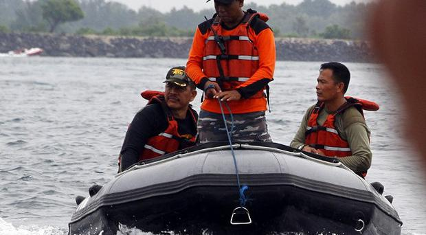 Indonesian navy rescue team members searched for the missing Japanese divers (AP)