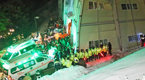 Rescue workers search for survivors from a collapsed building in Gyeongju, South Korea (AP)