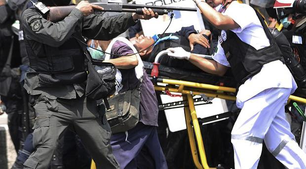 Clashes between protesters and police have left at least five dead in Bangkok