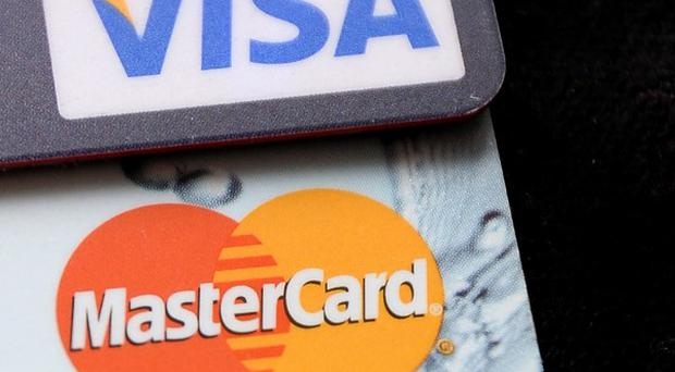 Visa and MasterCard announced internet-based technologies to make it easier for shoppers to buy things at retail stores without pulling out a credit card
