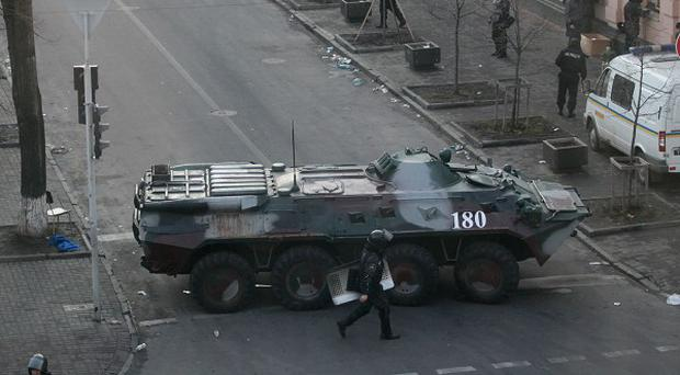 Police block the way with an armoured personnel carrier at the Ukraine's parliament in Kiev (AP)