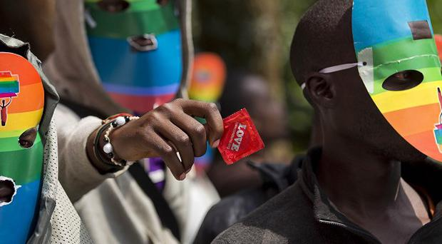 Kenyan gays and lesbians and supporters wear masks to preserve their anonymity as they stage a rare protest against Uganda's stance on homosexuality (AP Photo/Ben Curtis)