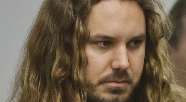 As I Lay Dying frontman Tim Lambesis has admitted trying to hire a hitman to kill his wife (AP)