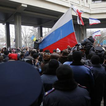 Troops and police in the Ukraine have been put on high alert after dozens of men seized local government and legislature buildings in the Crimea region