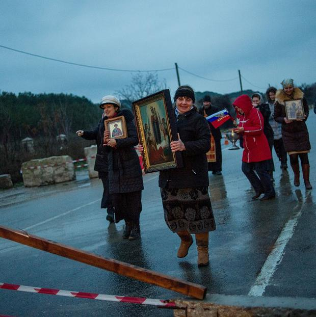 Pro-Russian activists carry Orthodox Icons at a checkpoint outside the Ukrainian Black Sea port of Sevastopol in the Crimea, Ukraine (AP)