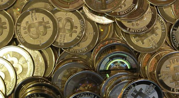 A weakness in the Bitcoin exchange's systems has been blamed for the massive loss of the virtual currency (AP)