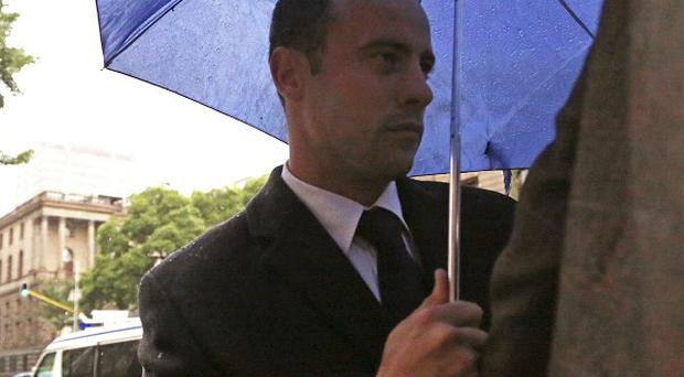 Oscar Pistorius arrives at the high court in Pretoria, South Africa, for his trial for the murder of his girlfriend, Reeva Steenkamp