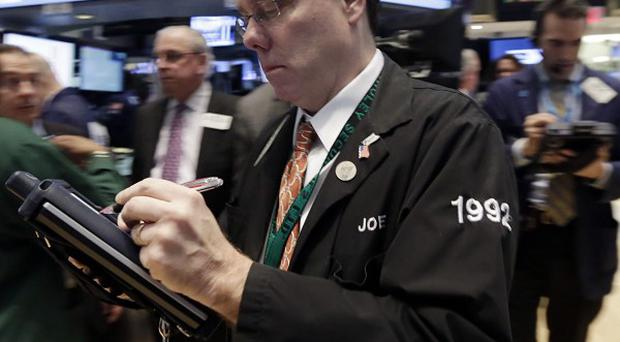 Trader Joseph Murray works on the floor of the New York Stock Exchange (AP)