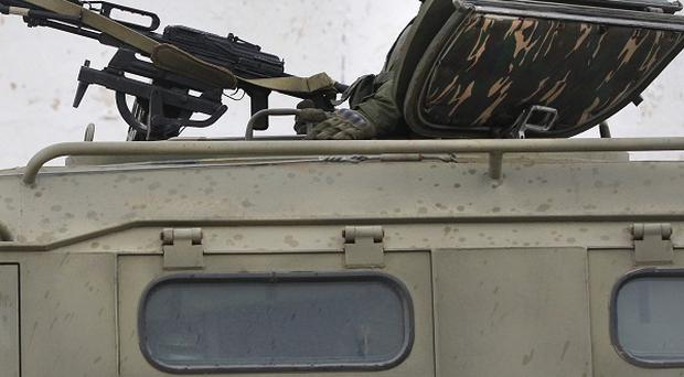 Pro-Russian soldiers guard Ukraine's infantry base in Perevalne. (AP)