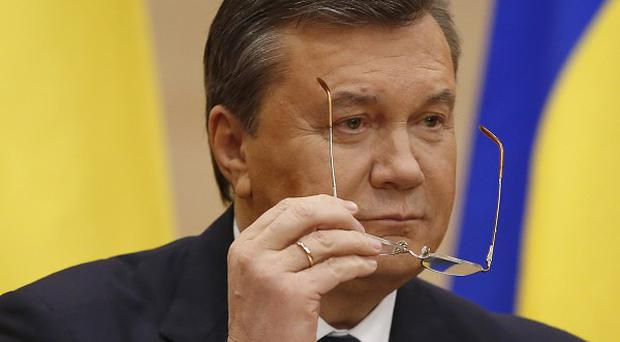 Ukraine's ousted president Viktor Yanukovych is among 18 people hit by EU sanctions (AP)
