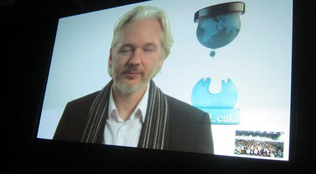 Julian Assange speaks via Skype at the South By SouthWest Interactive festival in Texas (AP)