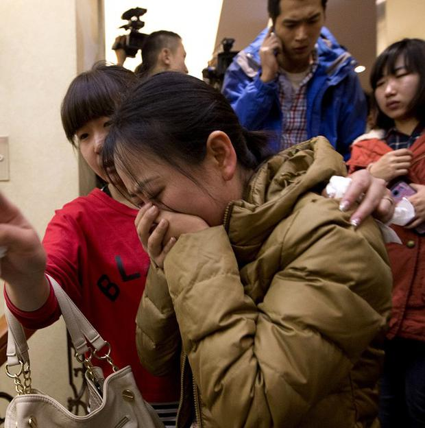 A Chinese relative of passengers aboard the missing Malaysia Airlines plane cries as she waits for news in Beijing (AP)