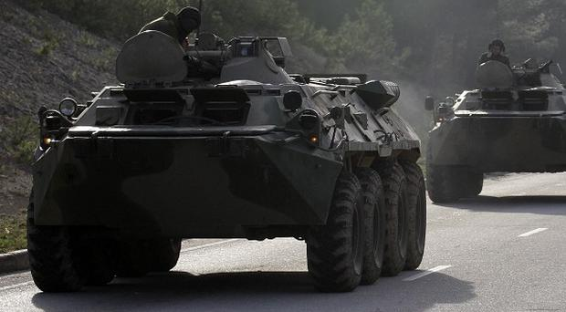 The Kremlin moves came as Russian forces strengthened their control over Crimea (AP)