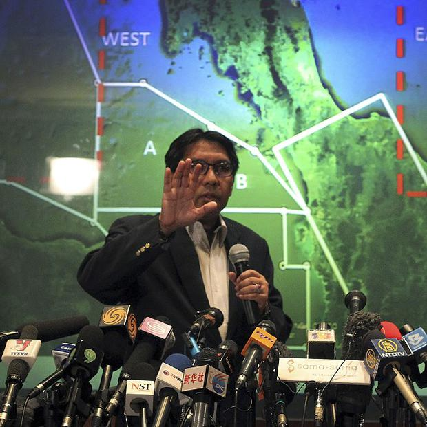 Civil aviation chief Azharuddin Abdul Rahman briefs reporters on the search for the missing Malaysia Airlines plane (AP)