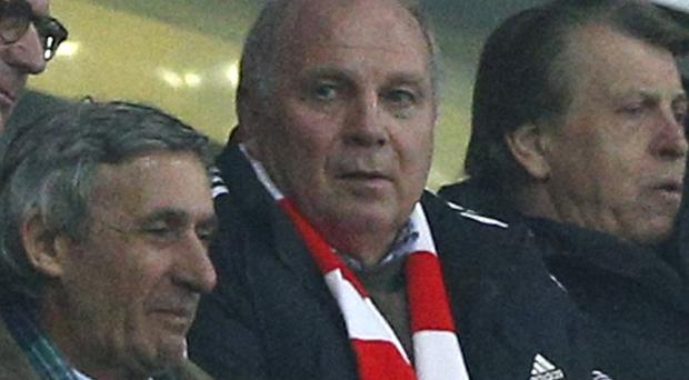 Uli Hoeness, centre, watched the Champions League match between Bayern and Arsenal on Tuesday night (AP)