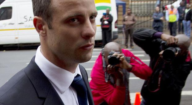Oscar Pistorius is on trial at the high court in Pretoria (AP)