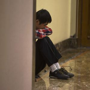 A relative of Chinese passengers aboard the missing Malaysia Airlines flight MH370 grieves alone in a corridor at a hotel in Beijing (AP)