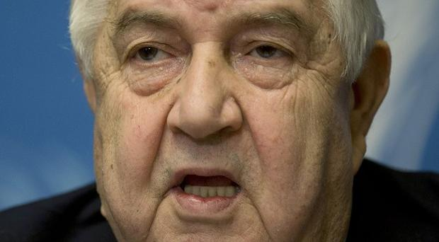 Syrian foreign minister Walid al-Moallem is being treated in a Beirut hospital (AP)