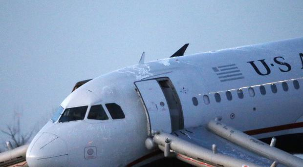 The damaged US Airways jet has now been removed from the end of a runway at Philadelphia International Airport (AP)