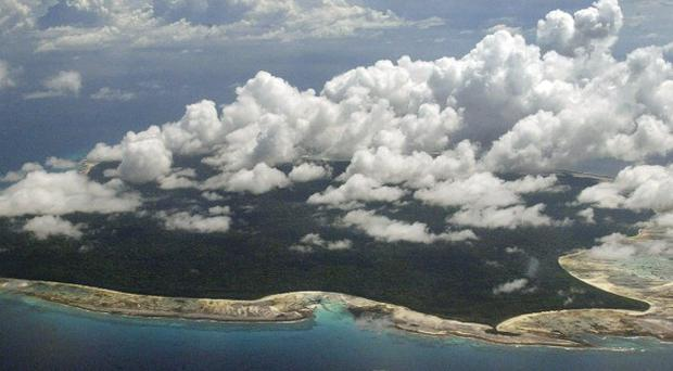 North Sentinel Island, in the Andaman and Nicobar Islands, is scoured for signs of the missing passenger plane (AP)