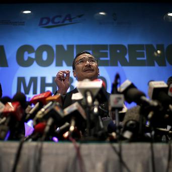 Transport minister Hishamuddin Hussein faces the media during a press conference about the missing Malaysia Airlines jetliner (AP)