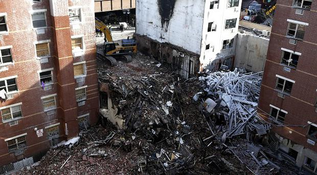 A natural gas explosion levelled two apartment buildings in New York (AP)